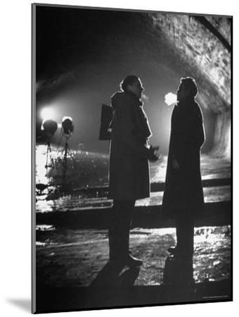 """Carol Reed Coaching Orson Welles as They Stand Against Floodlights During Filming """"The Third Man.""""-William Sumits-Mounted Premium Photographic Print"""