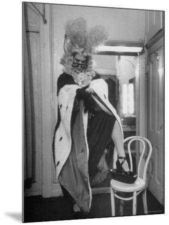 Soprano Patrice Munsel Costumed as Notary for Cosi Fan Tutte, Pulling onGloves in Dressing Room-Peter Stackpole-Mounted Premium Photographic Print