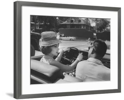 Gina Lollobrigida Taking a Driving Lesson-Peter Stackpole-Framed Premium Photographic Print