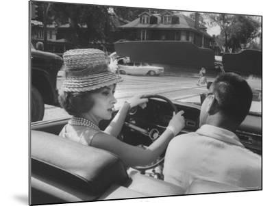 Gina Lollobrigida Taking a Driving Lesson-Peter Stackpole-Mounted Premium Photographic Print