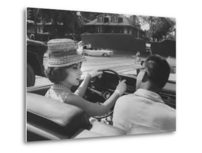 Gina Lollobrigida Taking a Driving Lesson-Peter Stackpole-Metal Print