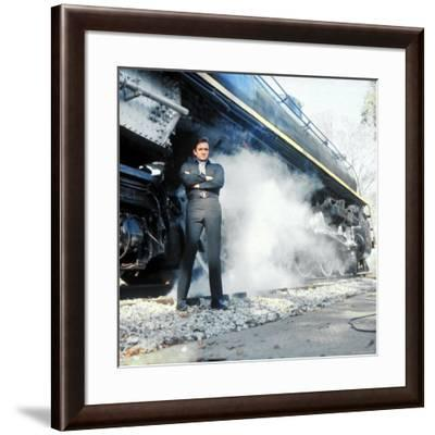 Country Music Star Johnny Cash Wearing Black Clothing and Standing in Front of a Locomotive-Michael Rougier-Framed Premium Photographic Print
