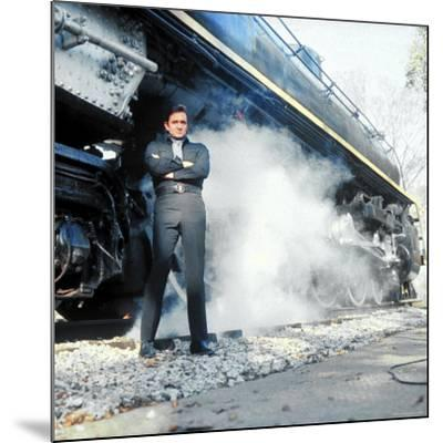 Country Music Star Johnny Cash Wearing Black Clothing and Standing in Front of a Locomotive-Michael Rougier-Mounted Premium Photographic Print