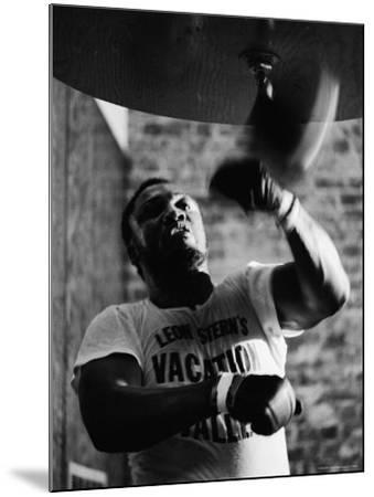 Boxing Champ Joe Frazier Working Out for His Scheduled Fight Against Muhammad Ali-John Shearer-Mounted Premium Photographic Print