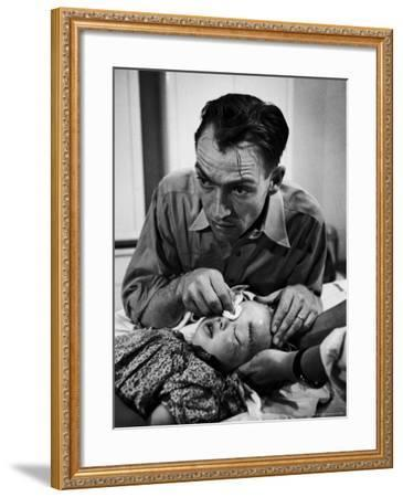 Country Dr. Ernest Ceriani Aftter girl gets stiches from being kicked in head by a Horse-W^ Eugene Smith-Framed Photographic Print
