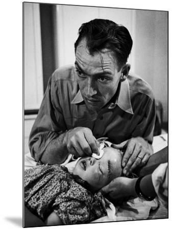 Country Dr. Ernest Ceriani Aftter girl gets stiches from being kicked in head by a Horse-W^ Eugene Smith-Mounted Photographic Print