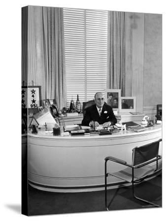 MGM Movie Mogul Louis B. Mayer, Sitting at His Desk in His Office-Walter Sanders-Stretched Canvas Print
