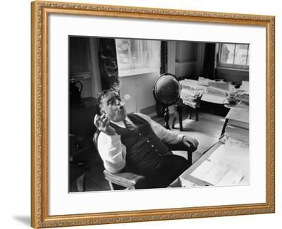 Mayor Fiorello LaGuardia Blowing Smoke Rings Sitting at Desk in His Office-William C^ Shrout-Framed Photographic Print