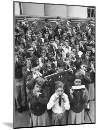 Uniformed Children Who Are Members of Levittown Harmonica Band Playing Harmonicas-Peter Stackpole-Mounted Photographic Print