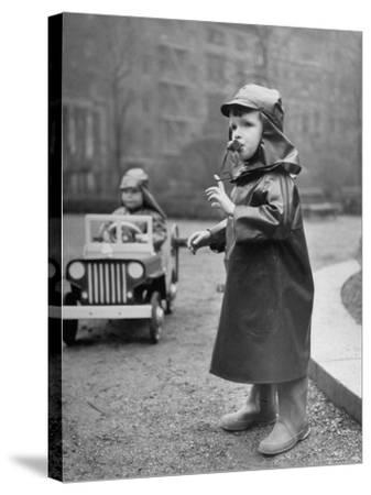 Little Boys at Play Wearing a Rainsuit-Nina Leen-Stretched Canvas Print