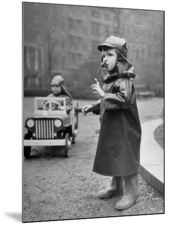 Little Boys at Play Wearing a Rainsuit-Nina Leen-Mounted Photographic Print