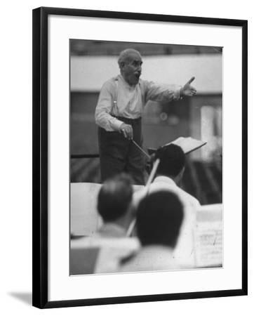Conductor Arturo Toscanini, Singing and Shouting Instructions While Rehearsing His Men in a Gym-Joe Scherschel-Framed Premium Photographic Print
