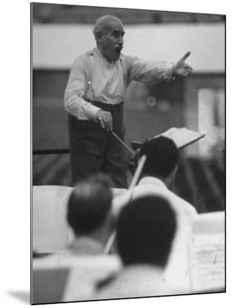 Conductor Arturo Toscanini, Singing and Shouting Instructions While Rehearsing His Men in a Gym-Joe Scherschel-Mounted Premium Photographic Print