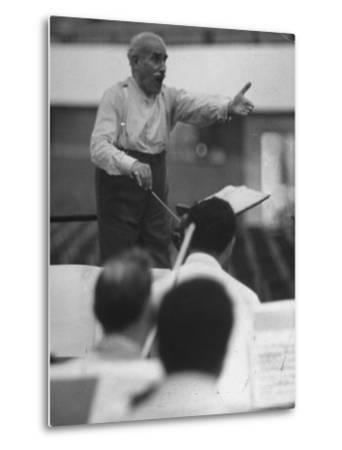 Conductor Arturo Toscanini, Singing and Shouting Instructions While Rehearsing His Men in a Gym-Joe Scherschel-Metal Print