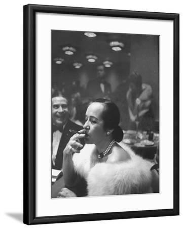Woman Tries Lady's Cigar in Club After Release of Surgeon General's Report on Smoking Hazards-Ralph Morse-Framed Photographic Print