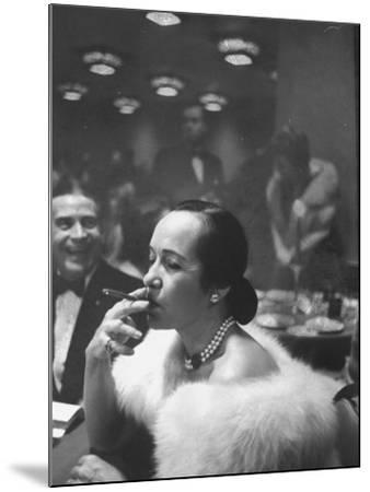 Woman Tries Lady's Cigar in Club After Release of Surgeon General's Report on Smoking Hazards-Ralph Morse-Mounted Photographic Print