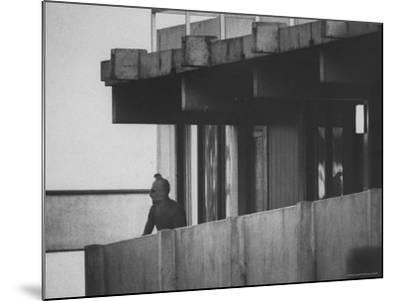 Masked Black September Arab Terrorist Looking from Balcony of Athletes Housing Complex-Co Rentmeester-Mounted Photographic Print