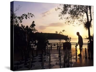 Playing Floor Chess at Sunset at Grand Lido Sans Souci Resort, Ocho Rios, Jamaica-Holger Leue-Stretched Canvas Print