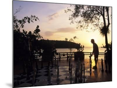 Playing Floor Chess at Sunset at Grand Lido Sans Souci Resort, Ocho Rios, Jamaica-Holger Leue-Mounted Photographic Print