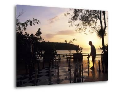 Playing Floor Chess at Sunset at Grand Lido Sans Souci Resort, Ocho Rios, Jamaica-Holger Leue-Metal Print
