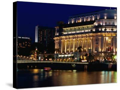 Fullerton Hotel at Night, Singapore, Singapore-Phil Weymouth-Stretched Canvas Print