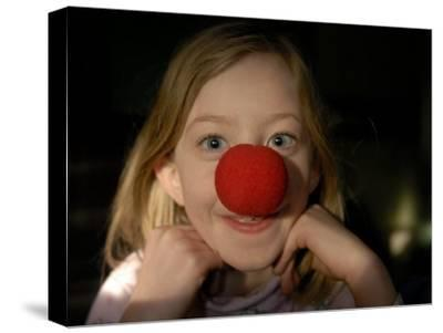 A Young Female Sports a Bright Red Clown Nose-Joel Sartore-Stretched Canvas Print