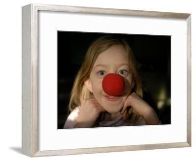 A Young Female Sports a Bright Red Clown Nose-Joel Sartore-Framed Photographic Print