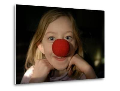 A Young Female Sports a Bright Red Clown Nose-Joel Sartore-Metal Print