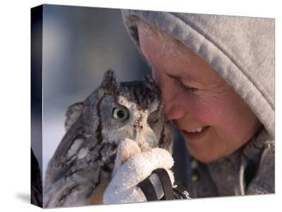 A Woman Holds an Endangered Eastern Screech Owl at a Recovery Center-Joel Sartore-Stretched Canvas Print
