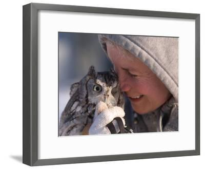 A Woman Holds an Endangered Eastern Screech Owl at a Recovery Center-Joel Sartore-Framed Photographic Print