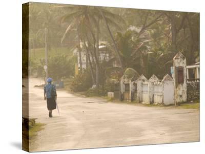 Woman Walking in Sea Mist, Bathsheba, Barbados-Walter Bibikow-Stretched Canvas Print