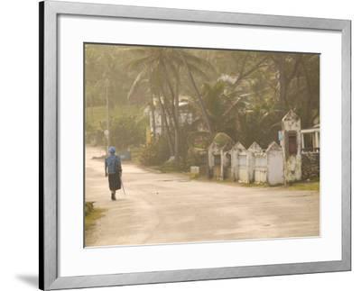 Woman Walking in Sea Mist, Bathsheba, Barbados-Walter Bibikow-Framed Photographic Print