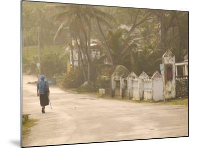 Woman Walking in Sea Mist, Bathsheba, Barbados-Walter Bibikow-Mounted Photographic Print