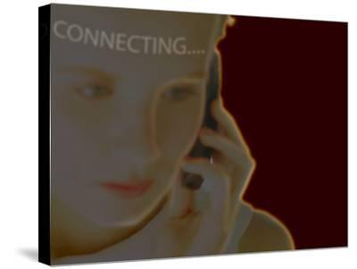 Woman Using Cell Phone with Superimposed Word Connecting--Stretched Canvas Print