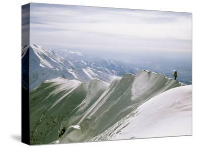 Mountain Climber Hikes along a Mountain Ridge in Denali-Bill Hatcher-Stretched Canvas Print