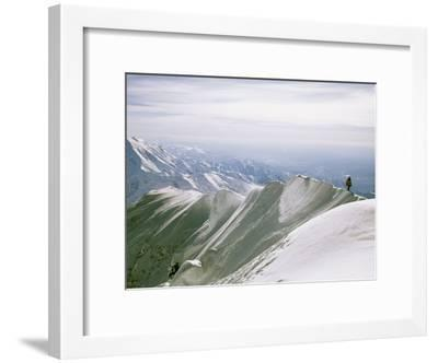 Mountain Climber Hikes along a Mountain Ridge in Denali-Bill Hatcher-Framed Photographic Print