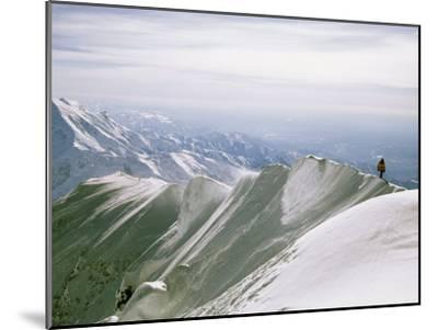 Mountain Climber Hikes along a Mountain Ridge in Denali-Bill Hatcher-Mounted Photographic Print