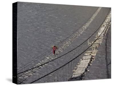 A Hunzukut Woman Crosses a Footbridge over the Hunza River, Constructed of Tied Juniper Branches-Jonathan Blair-Stretched Canvas Print