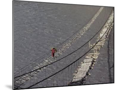 A Hunzukut Woman Crosses a Footbridge over the Hunza River, Constructed of Tied Juniper Branches-Jonathan Blair-Mounted Photographic Print