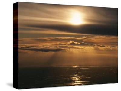Sunset and Clouds over the Ocean-Peter Carsten-Stretched Canvas Print