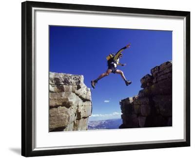 Hiker Jumping, High Uintas, UT-Cheyenne Rouse-Framed Photographic Print