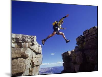 Hiker Jumping, High Uintas, UT-Cheyenne Rouse-Mounted Photographic Print