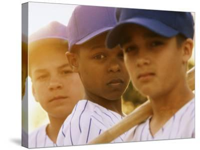 Portrait of Three Boys in Full Baseball Uniforms--Stretched Canvas Print