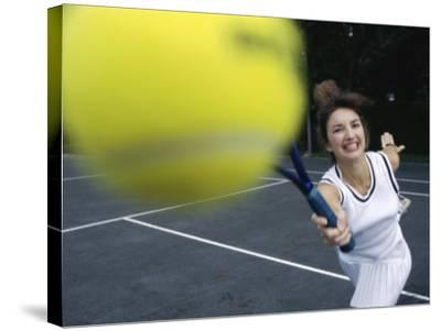 Close-up of a Young Woman Playing Tennis--Stretched Canvas Print