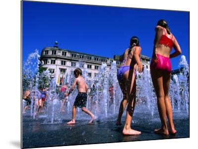 Children Playing in Piccadilly Gardens Waterjets, Manchester, England-Mark Daffey-Mounted Photographic Print