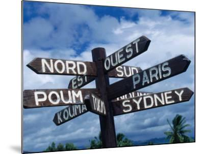 Sign Showing Directions to Other Cities in World, Koumac, New Caledonia-Jean-Bernard Carillet-Mounted Photographic Print
