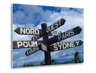 Sign Showing Directions to Other Cities in World, Koumac, New Caledonia-Jean-Bernard Carillet-Metal Print