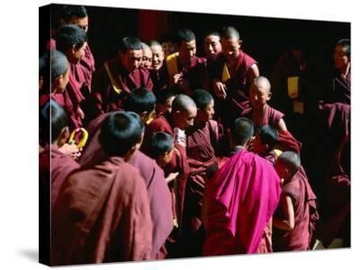 Monks Gathered in Courtyard of Historic Ganden Monastery, Ganden, Tibet-Richard I'Anson-Stretched Canvas Print
