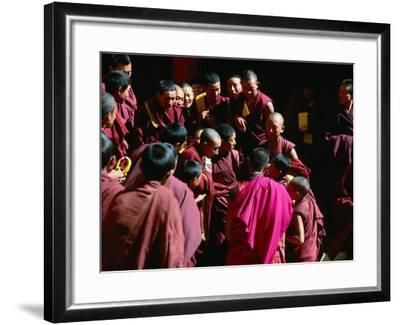 Monks Gathered in Courtyard of Historic Ganden Monastery, Ganden, Tibet-Richard I'Anson-Framed Photographic Print