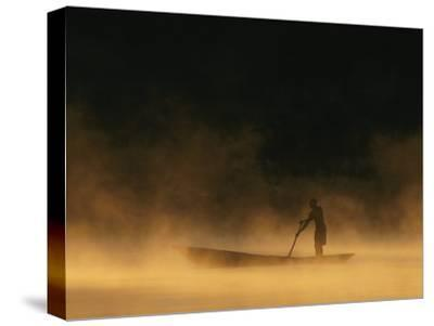 Night Fisherman in a Dugout Canoe on the Zambezi River-Chris Johns-Stretched Canvas Print